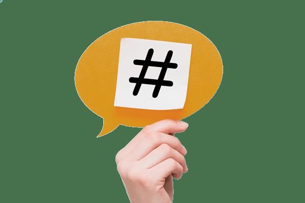 mano con hashtag para servicios marketing de online en etapas de definicion de estrategias